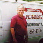 old associated piping van with man standing in front